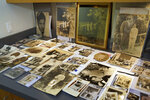 """A collection of photographs from the estate of mob boss Al Capone is seen on display at Witherell's Auction House in Sacramento, Calif., Wednesday, Aug. 25, 2021. The photographs are among the 174 family heirlooms that will be up for sale at an Oct. 8 auction titled """"A Century of Notoriety: The Estate of Al Capone,"""" that will be held by Witherell's in Sacramento. (AP Photo/Rich Pedroncelli)"""