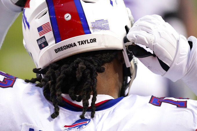 Buffalo Bills offensive tackle Ty Nsekhe wears the name Breonna Taylor on the back of his helmet before the AFC championship NFL football game against the Kansas City Chiefs, Sunday, Jan. 24, 2021, in Kansas City, Mo. (AP Photo/Jeff Roberson)