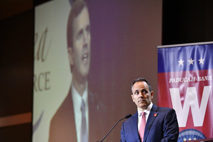 Kentucky Governor and Republican candidate for Governor Matt Bevin looks on as Attorney General and Democratic candidate Andy Beshear responds to a question during a debate in Paducah, Ky., Thursday, Oct. 3, 2019. (AP Photo/Timothy D. Easley)