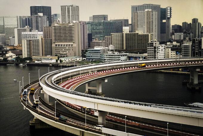 Motorists drive along a spiral ramp onto the Rainbow Bridge, Tuesday, July 13, 2021, in Tokyo. (AP Photo/Jae C. Hong)