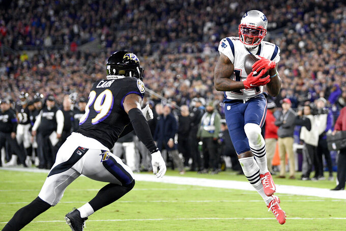 New England Patriots wide receiver Mohamed Sanu (14) makes a touchdown catch on a pass from quarterback Tom Brady, not visible, as Baltimore Ravens safety Jordan Richards (39) defends during the first half of an NFL football game, Sunday, Nov. 3, 2019, in Baltimore. (AP Photo/Nick Wass)