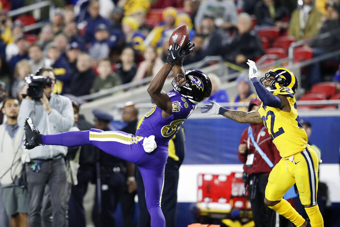 Baltimore Ravens wide receiver Miles Boykin catches a pass in front of Los Angeles Rams cornerback Troy Hill during the second half of an NFL football game Monday, Nov. 25, 2019, in Los Angeles. (AP Photo/Marcio Jose Sanchez)