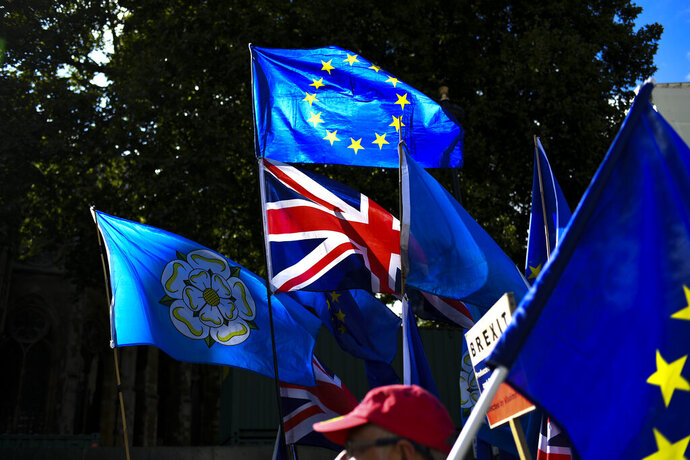 Anti Brexit demonstrators gather and march at Parliament Square, in London, Tuesday, Sept. 3, 2019. Lawmakers returned from their summer recess Tuesday for a pivotal day in British politics as they challenged Prime Minister Boris Johnson's insistence that the U.K. leave the European Union on Oct. 31, even without a withdrawal agreement to cushion the economic blow. (AP Photo/Alberto Pezzali)