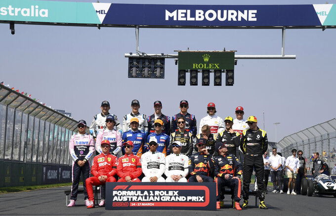 In this March 17, 2019, file photo, drivers pose for a group photo ahead of the Australian Formula 1 Grand Prix in Melbourne, Australia. The start of the Formula One season has been delayed after the Australian Grand Prix was postponed because of the coronavirus pandemic. The Australian race in Melbourne has been rescheduled from March 21 to November 21. (AP Photo/Andy Brownbill, File)