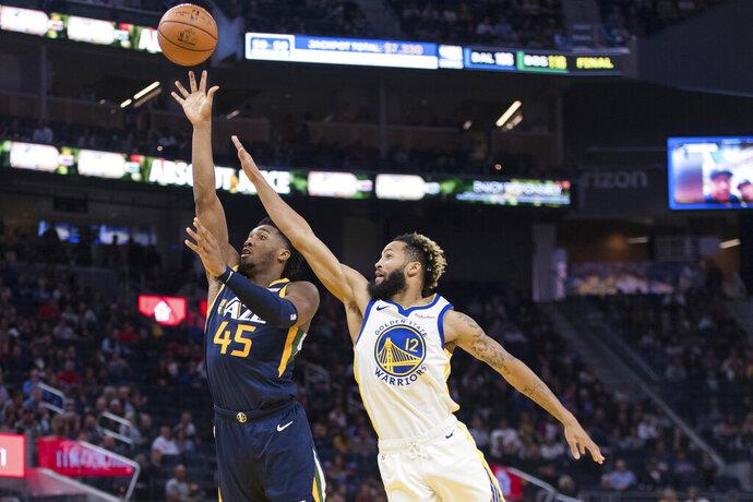 Utah Jazz guard Donovan Mitchell (45) shoots as Golden State Warriors guard Ky Bowman (12) defends in the second half of an NBA basketball game in San Francisco, Monday, Nov. 11, 2019. The Jazz won 122-108. (AP Photo/John Hefti)