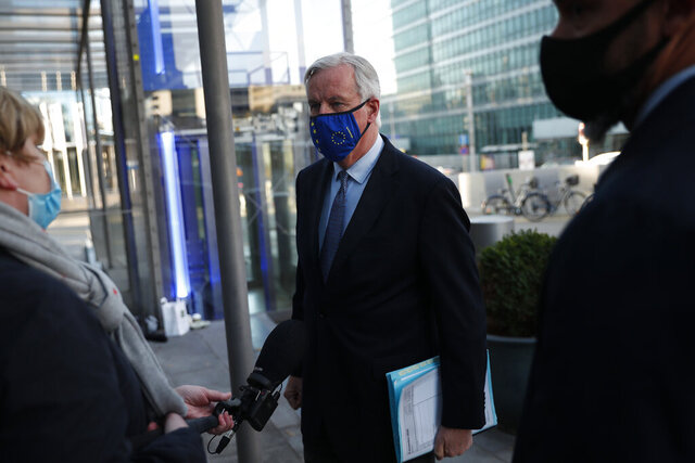 European Commission's Head of Task Force for Relations with the United Kingdom Michel Barnier talks to journalists as he leaves the European Commission headquarters in Brussels, Wednesday, Nov. 4, 2020. Barnier on Wednesday briefed the European Union ambassadors on the state of negotiations with the United Kingdom, as both sides continue to struggle to find common ground on a free trade deal which needs to be in place by Jan. 1. (AP Photo/Francisco Seco)