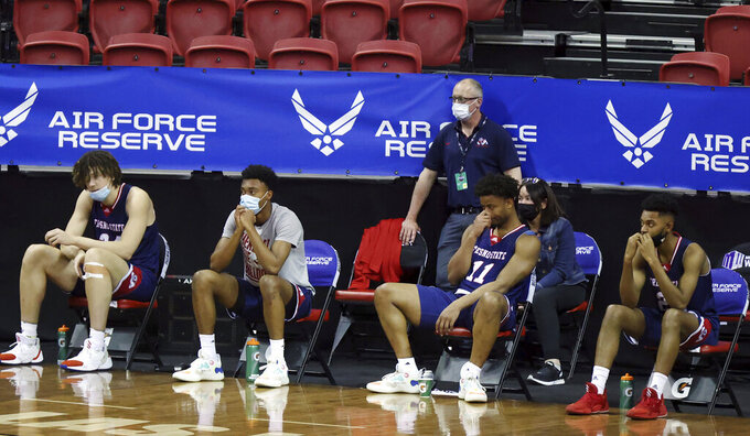 The Fresno State bench watches the final minutes of the team's NCAA college basketball game against Colorado State in the quarterfinals of the Mountain West Conference men's tournament Thursday, March 11, 2021, in Las Vegas. (AP Photo/Isaac Brekken)