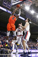 Pacific guard Jahlil Tripp, left, shoots next to Gonzaga forwards Filip Petrusev, right, and Killian Tillie during the first half of an NCAA college basketball game in Spokane, Wash., Saturday, Jan. 25, 2020. (AP Photo/Young Kwak)
