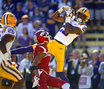 "FILE - In this Nov. 11, 2017, file photo, LSU cornerback Andraez ""Greedy"" Williams (29) pulls in an interception in the end zone late in the second half of an NCAA college football game against Arkansas in Baton Rouge, La. Williams is a possible pick in the 2019 NFL Draft. (AP Photo/Gerald Herbert, File)"