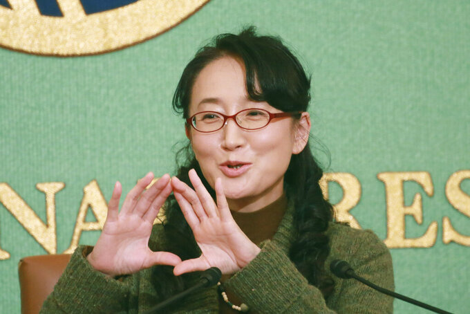 """Japanese writer Yu Miri speaks during a news conference in Tokyo on Wednesday, Dec. 23, 2020. Miri's novel """"Tokyo Ueno Station"""" has won the National Book Award 2020 for Translated Literature in the United States. (AP Photo/Koji Sasahara)"""