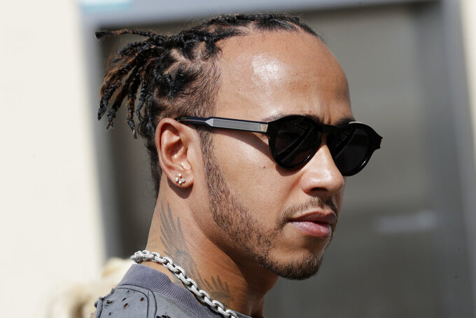 Mercedes driver Lewis Hamilton of Britain arrives at the Yas Marina racetrack in Abu Dhabi, United Arab Emirates, Thursday, Nov. 28, 2018. The Emirates Formula One Grand Prix will take place on Sunday. (AP Photo/Luca Bruno)
