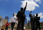 Protesters gather in front of Dallas City Hall in downtown Dallas, Saturday, May 30, 2020. Protests across the country have escalated over the death of George Floyd who died after being restrained by Minneapolis police officers on Memorial Day. (AP Photo/LM Otero)