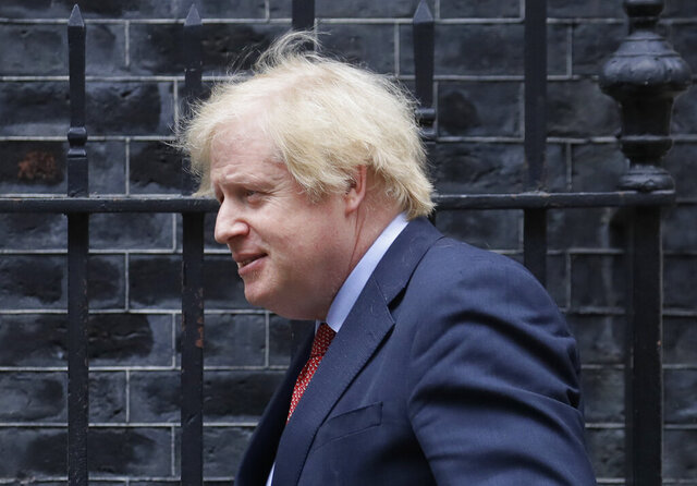 Britain's Prime Minister Boris Johnson leaves 10 Downing Street to attend the weekly session of PMQs in Parliament in London, Wednesday, June 10, 2020. (AP Photo/Kirsty Wigglesworth)