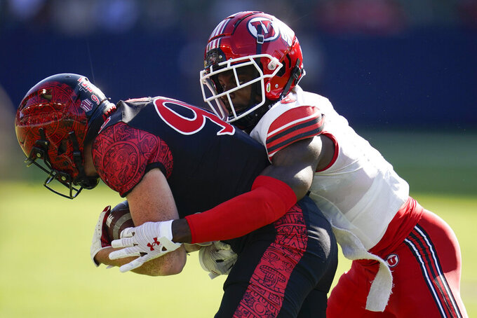 San Diego State wide receiver Elijah Kothe (96) is tackled by Utah cornerback Clark Phillips III (8) during the first half of an NCAA college football game Saturday, Sept. 18, 2021, in Carson, Calif. (AP Photo/Ashley Landis)