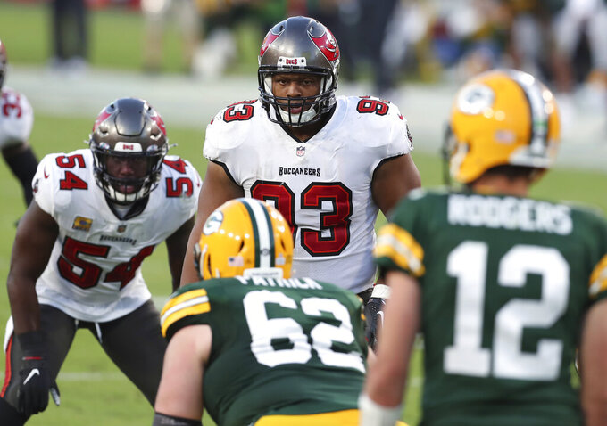 FILE - In this Oct. 18, 2020, file photo, Tampa Bay Buccaneers defensive end Ndamukong Suh (93) and inside linebacker Lavonte David (54) line up against the Green Bay Packers during the second half of an NFL football game in Tampa, Fla. Suh has agreed to a one-year contract worth $9 million to remain with the Super Bowl champion Buccaneers, a person familiar with the deal told The Associated Press. (AP Photo/Mark LoMoglio, File)