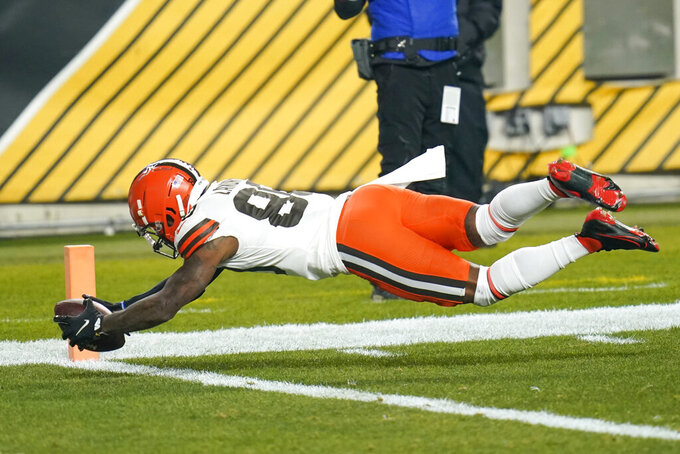 Cleveland Browns wide receiver Jarvis Landry (80) dives into the end zone for a touchdown in a 40-yard pass play during the first half of an NFL wild-card playoff football game against the Pittsburgh Steelers, Sunday, Jan. 10, 2021, in Pittsburgh. (AP Photo/Keith Srakocic)