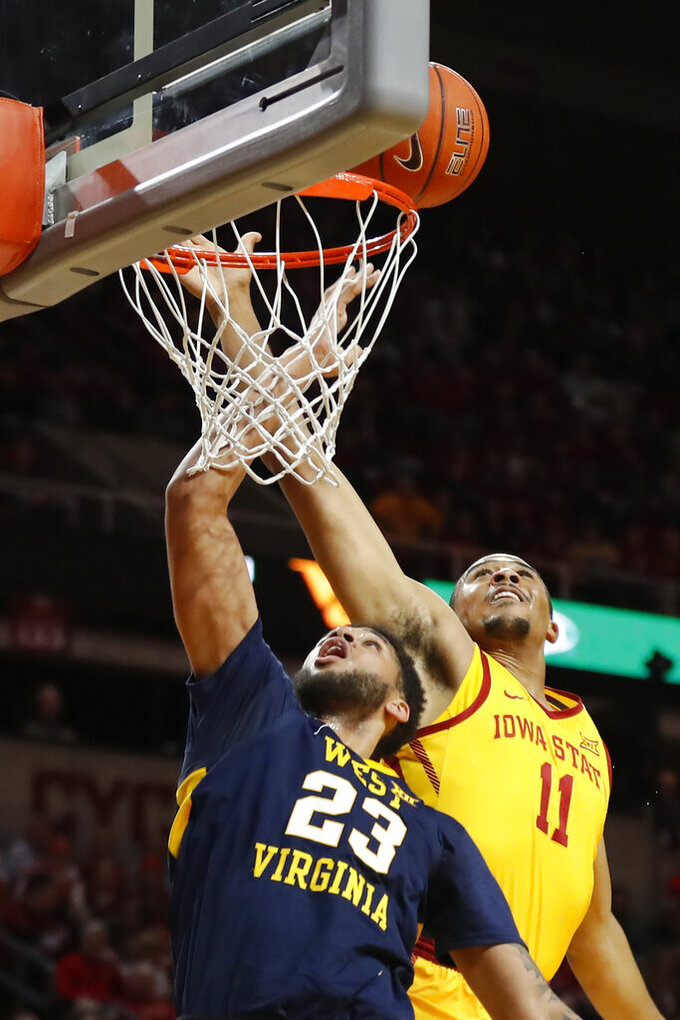 Iowa State guard Talen Horton-Tucker (11) blocks a shot by West Virginia forward Esa Ahmad (23) during the first half of an NCAA college basketball game Wednesday, Jan. 30, 2019, in Ames, Iowa. (AP Photo/Charlie Neibergall)