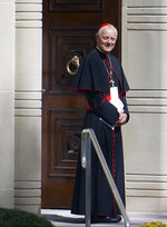 FILE - In this Wednesday, Sept. 23, 2015 file photo Cardinal Donald Wuerl, archbishop of Washington, stands in the doorway of the Apostolic Nunciature, the Vatican's diplomatic mission in Washington. Pope Francis has accepted Friday Oct. 12, 2108 the resignation of Washington Cardinal Donald Wuerl after he became entangled in two major sexual abuse and cover-up scandals and lost the support of many in his flock.  (AP Photo/Cliff Owen, File)