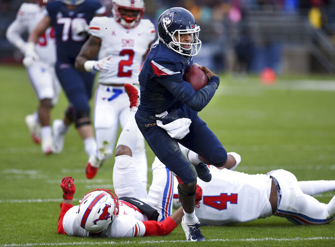 Connecticut quarterback David Pindell (5) runs the ball in for UConn's first touchdown in the first half of an NCAA college football game against SMU, Saturday, Nov. 10, 2018, in East Hartford, Conn.(AP Photo/Stephen Dunn)