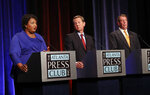 Democratic gubernatorial candidate for Georgia Stacey Abrams, left, speaks as Republican Secretary of State Brian Kemp, and Libertarian Ted Metz, right, look on during a debate Tuesday, Oct. 23, 2018, in Atlanta. (AP Photo/John Bazemore)