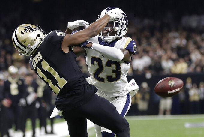 FILE - In this Jan. 20, 2019, file photo, Los Angeles Rams' Nickell Robey-Coleman breaks up a pass intended for New Orleans Saints' Tommylee Lewis during the second half of the NFL football NFC championship game in New Orleans. The NFL's competition committee discussed the league's replay system during its annual meeting in Indianapolis but reached no consensus on possible changes. And it may not recommend any major alterations. Officiating and the use of replays have been under scrutiny since a missed pass interference call and helmet-first hit in the final two minutes of the NFC championship game helped the Los Angeles Rams force overtime and eventually reach the Super Bowl. (AP Photo/Gerald Herbert, File)