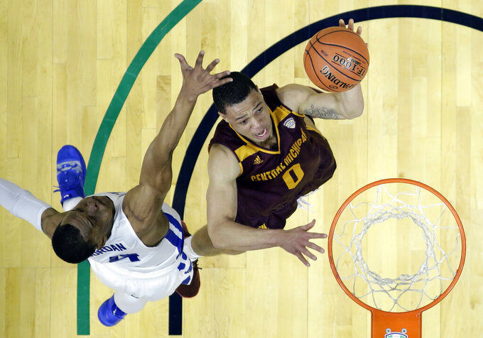 Central Michigan's Larry Austin Jr. (0) drives to the basket against Buffalo's Davonta Jordan (4) during the first half of an NCAA college basketball game in the semifinals of the Mid-American Conference men's tournament Friday, March 15, 2019, in Cleveland. Buffalo won 85-81. (AP Photo/Tony Dejak)