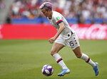United States' Megan Rapinoe runs with the ball during the Women's World Cup final soccer match between US and The Netherlands at the Stade de Lyon in Decines, outside Lyon, France, Sunday, July 7, 2019. (AP Photo/Francisco Seco)