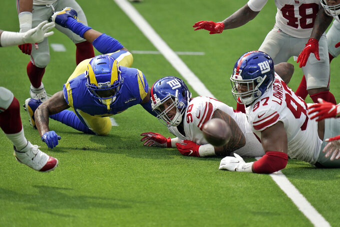 Los Angeles Rams tight end Gerald Everett, left, fumbles the ball which would then be recovered by the New York Giants during the first half of an NFL football game Sunday, Oct. 4, 2020, in Inglewood, Calif. (AP Photo/Jae C. Hong)