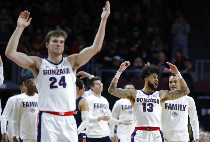 Gonzaga's Josh Perkins (13) and Corey Kispert (24) celebrate after a play against Pepperdine during the second half of an NCAA semifinal college basketball game at the West Coast Conference tournament, Monday, March 11, 2019, in Las Vegas. (AP Photo/John Locher)