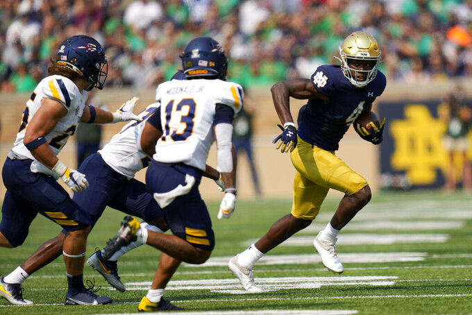 Notre Dame wide receiver Kevin Austin Jr. (4) runs in front of Toledo cornerback Chris McDonald (13) in the first half of an NCAA college football game in South Bend, Ind., Saturday, Sept. 11, 2021. (AP Photo/AJ Mast)