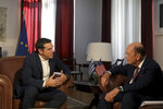 Greek Prime Minister Alexis Tsipras, left, meets with U.S. Commerce Secretary Wilbur Ross in the northern port city of Thessaloniki , Greece, on Friday, Sept 7, 2018.Thousands of police officers took up positions Friday around Greece's second-largest city ahead of anti-austerity protests at a trade fair where Tsipras met senior U.S. officials and is set to outline his post-bailout economic policy platform. (AP Photo/Dimitris Tosidis)