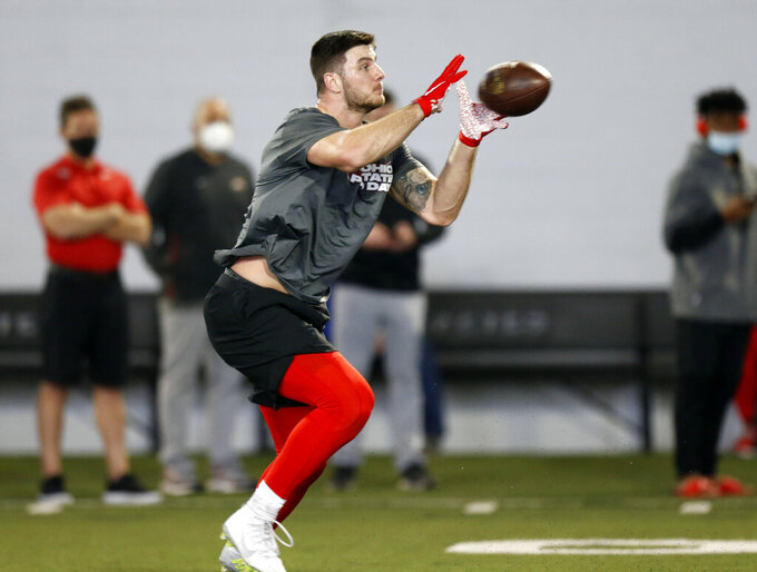 Ohio State tight end Luke Farrell makes a catch during an NFL Pro Day at Ohio State University on Tuesday, March 30, 2021, in Columbus, Ohio. (AP Photo/Paul Vernon)