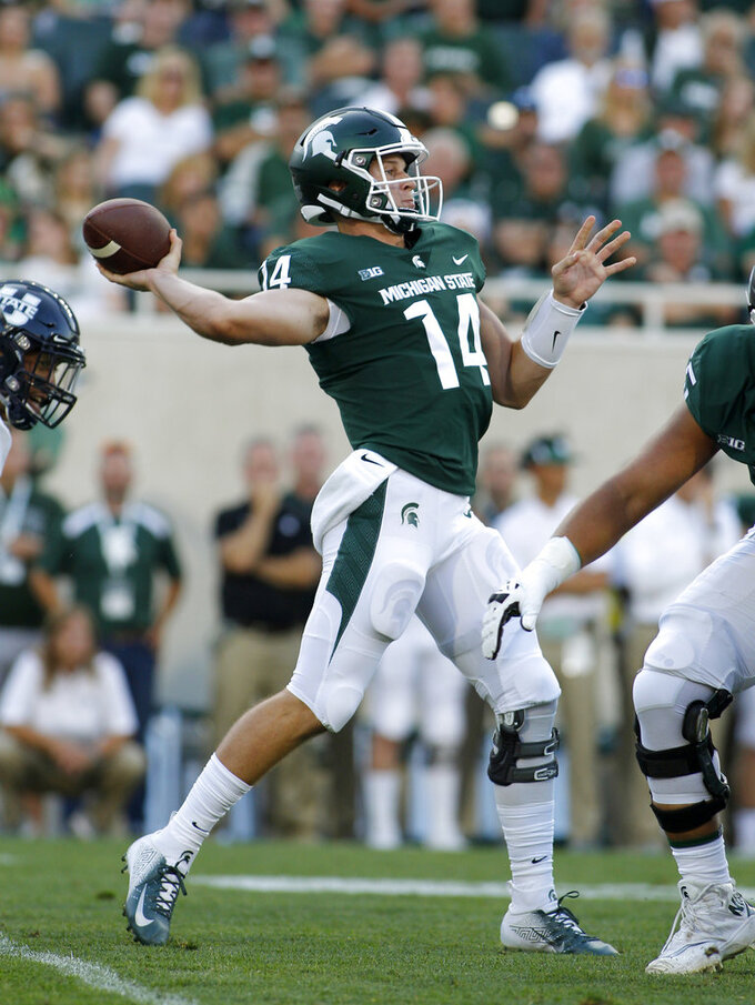 Michigan State quarterback Brian Lewerke throws a pass against Utah State during the first quarter of an NCAA college football game, Friday, Aug. 31, 2018, in East Lansing, Mich. (AP Photo/Al Goldis)