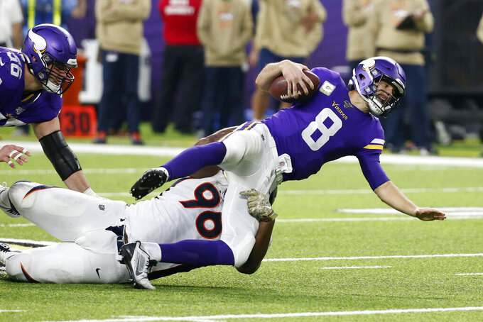 Minnesota Vikings quarterback Kirk Cousins (8) is sacked by Denver Broncos defensive tackle Shelby Harris (96) during the second half of an NFL football game, Sunday, Nov. 17, 2019, in Minneapolis. (AP Photo/Bruce Kluckhohn)