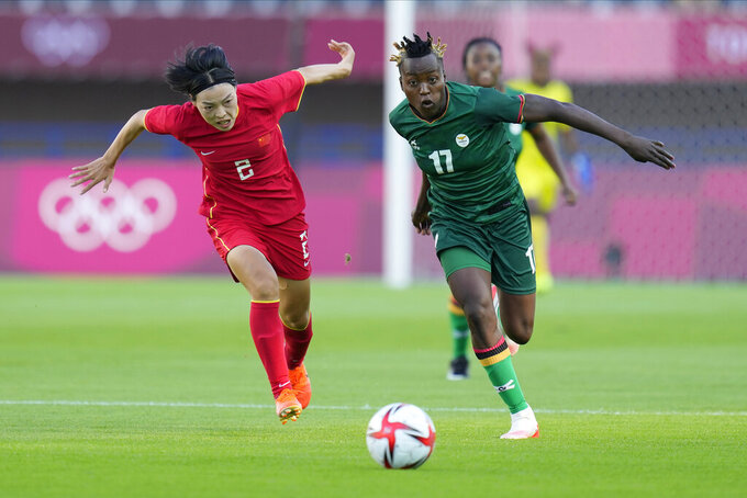 Zambia's Racheal Kundananji and China's Li Mengwen battle for the ball during a women's soccer match at the 2020 Summer Olympics, Saturday, July 24, 2021, in Miyagi, Japan. (AP Photo/Andre Penner)