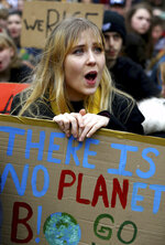 A young student takes part in a global school strike for climate change in Canterbury, south east England, Friday March 15, 2019. Students mobilized by word of mouth and social media skipped class Friday to protest what they believe are their governments' failure to take though action against global warming. (Gareth Fuller/PA via AP)