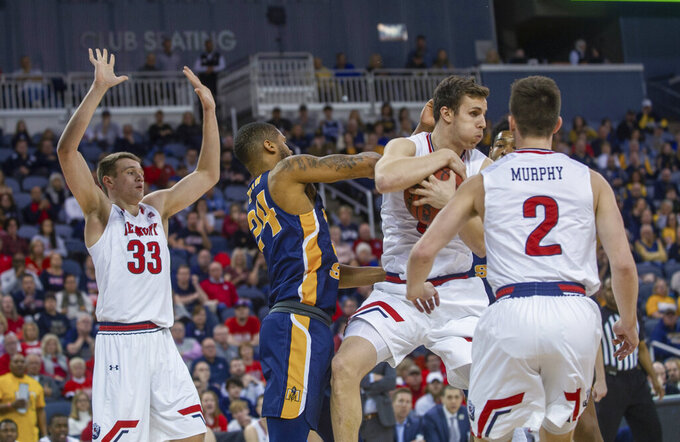 Belmont's Tyler Scablon gets control of the rebound away from as Murray State's Anthony Smith (24) as Belmont's Nick Muszynski (33) and Grayson Murphy (2) watch during the first half of an NCAA college basketball game for the championship of the Ohio Valley Conference tournament Saturday, March 7, 2020, in Evansville, Ind. (AP Photo/Daniel R. Patmore)