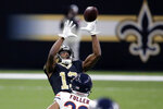 New Orleans Saints wide receiver Michael Thomas (13) pulls in a pass over Chicago Bears cornerback Kyle Fuller in the second half of an NFL wild-card playoff football game in New Orleans, Sunday, Jan. 10, 2021. (AP Photo/Butch Dill)