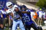 North Carolina wide receiver Emery Simmons (0) makes a touchdown catch as Duke cornerback Jeremiah Lewis (39) defends during the first half of an NCAA college football game at Wallace Wade Stadium, Saturday, Nov. 7, 2020, in Durham, N.C. (Jim Dedmon/Pool Photo via AP)