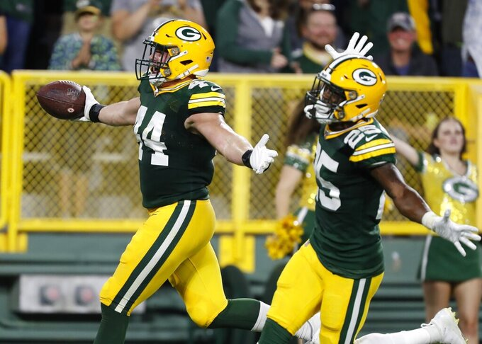 Green Bay Packers' Ty Summers celebrates after his 74-yard interception return for a touchdown during the first half of a preseason NFL football game against the Kansas City Chiefs Thursday, Aug. 29, 2019, in Green Bay, Wis. (AP Photo/Matt Ludtke)