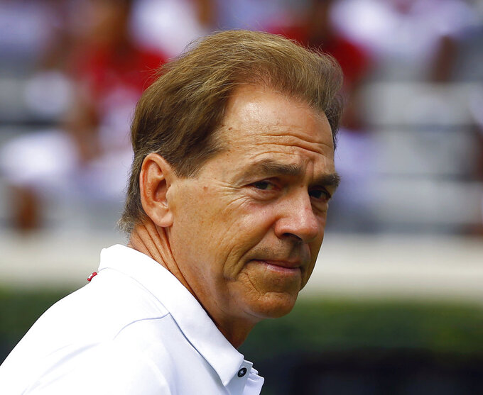 FILE - In this Aug. 4, 2018, file photo, Alabama head coach Nick Saban walks around the field before an NCAA college football practice, in Tuscaloosa, Ala. Saban had to recruit six assistant coaches during the offseason while elevating two others to coordinator positions. He landed a group he's hoping will help the top-ranked Crimson Tide contend for not only more championships but more of the nation's top prospects. (AP Photo/Butch Dill, File)