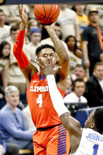 Clemson's Shelton Mitchell (4) shoots over Pittsburgh's Xavier Johnson (1) during the second half of an NCAA college basketball game, Wednesday, Feb. 27, 2019, in Pittsburgh. Clemson won 62-48. (AP Photo/Keith Srakocic)