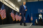 President Donald Trump arrives to deliver remarks on healthcare at Charlotte Douglas International Airport, Thursday, Sept. 24, 2020, in Charlotte, N.C. (AP Photo/Evan Vucci)