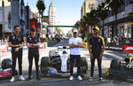 Red Bull Racing driver Alex Albon, Red Bull Racing driver Max Verstappen, Mercedes driver Valtteri Bottas and Renault F1 Team driver Daniel Ricciardo, from left, stand by their cars along Hollywood Boulevard in the Hollywood section of Los Angeles on Wednesday, Oct. 30, 2019. The drivers showed off their F1 cars along a closed-off section of the famed boulevard in front of the famed Grauman's Chinese Theatre. They even did burnouts with Jimmy Kimmel outside the talk show host's theater. (AP Photo/Richard Vogel)