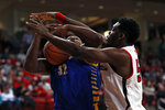 Texas Tech's Russel Tchewa (54) blocks the ball as Cal State Bakersfield's Shawn Stith (32) travels during the first half of an NCAA college basketball game Sunday, Dec. 29, 2019, in Lubbock, Texas. (AP Photo/Brad Tollefson)