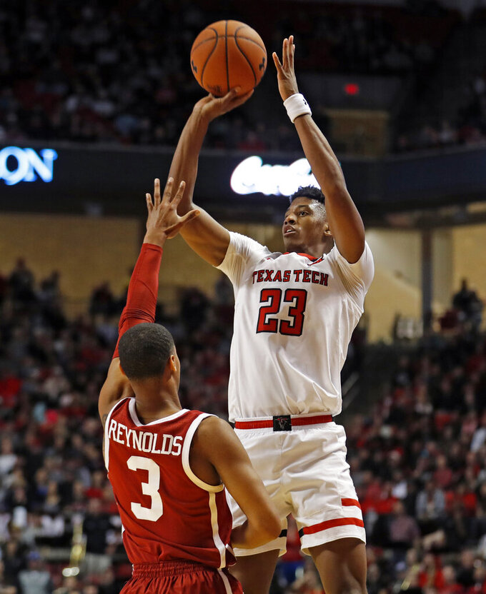 FILE - In this Jan. 8, 2019, file photo, Texas Tech's Jarrett Culver (23) shoots over Oklahoma's Miles Reynolds (3) during the second half of an NCAA college basketball game, in Lubbock, Texas. Culver was named the Big 12 Conference Player of the Year, Tuesday, March 12, 2019.(AP Photo/Brad Tollefson, File)