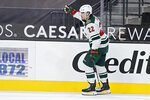Minnesota Wild left wing Kevin Fiala (22) celebrates after scoring against the Vegas Golden Knights during a shootout in an NHL hockey game Thursday, April 1, 2021, in Las Vegas. (AP Photo/John Locher)