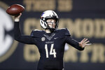Vanderbilt quarterback Kyle Shurmur (14) throws a pass against Mississippi during the second half of an NCAA college football game Saturday, Nov. 17, 2018, in Nashville, Tenn. Vanderbilt won 36-29 in overtime. (AP Photo/Mark Humphrey)