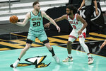 Charlotte Hornets forward Gordon Hayward (20) is guarded by Chicago Bulls guard Coby White (0) during the second half of an NBA basketball game in Charlotte, N.C., Friday, Jan. 22, 2021. (AP Photo/Jacob Kupferman)