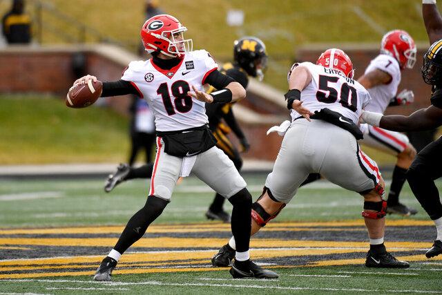 Georgia quarterback JT Daniels throws during the first half of an NCAA college football against Missouri game Saturday, Dec. 12, 2020, in Columbia, Mo. (AP Photo/L.G. Patterson)